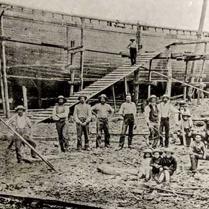John H. Pratt schooner under construction at a Madison wharf in 1890 by W. C. Crossly.