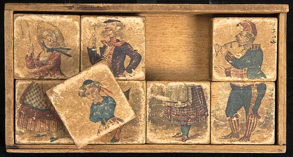 Child's set of wooden blocks covered on all sides in lithographs which can be arranged into puzzle figures.